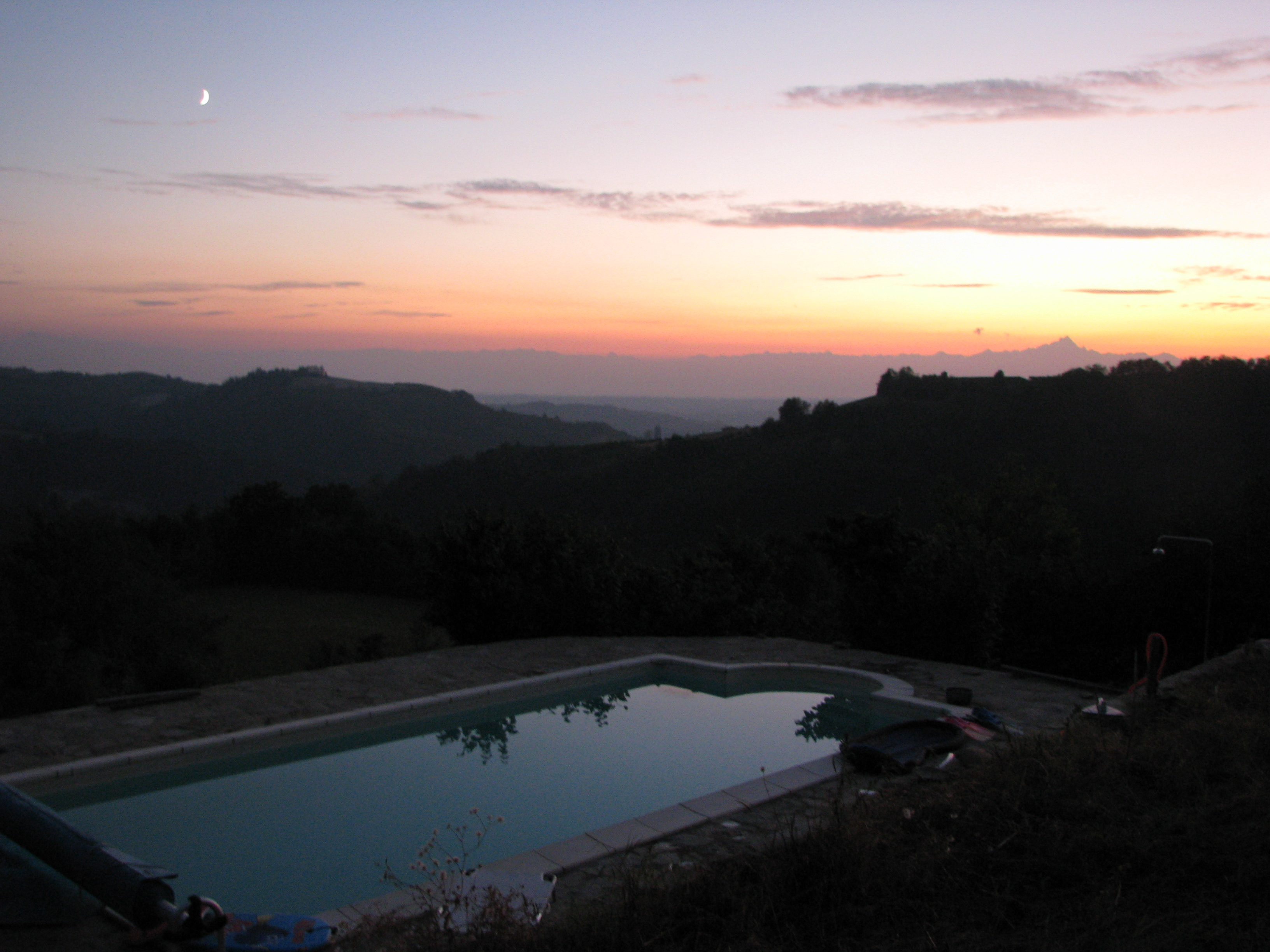 Zwembad La Casa Vecchia bij avondlicht